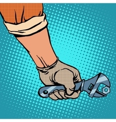 Hand and working the wrench vector image