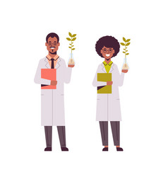 Scientists couple examining plant sample in test vector