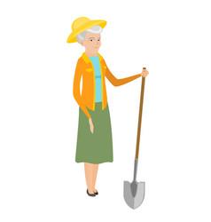 Senior caucasian farmer holding a shovel vector
