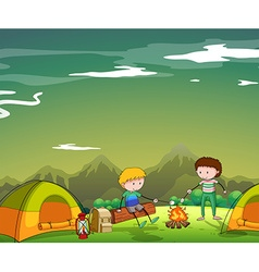 Two men camping out on the mountain vector image