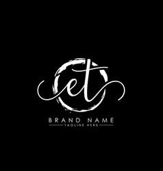 E and t initial handwriting logo design vector