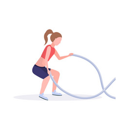 Sporty woman doing crossfit exercises with battle vector