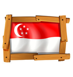 singapore flag in wooden frame vector image vector image