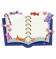 A book surrounded with sweet candies vector image