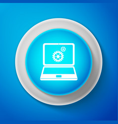 laptop and gears icon isolated on blue background vector image