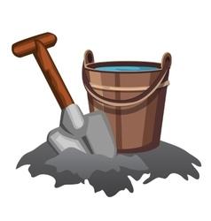 Bucket water and shovel in ground vector