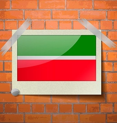 Flags Tatarstan scotch taped to a red brick wall vector