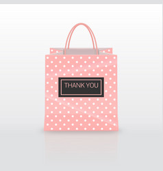 Realistic pink paper shopping bag with handles vector