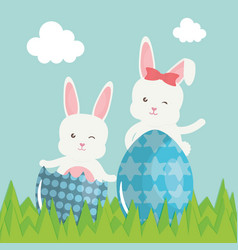 cute rabbits with easter eggs painted in the field vector image