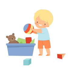 Little boy gathering his toys and tidy up his room vector