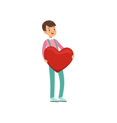 happy teen boy holding red heart happy valentines vector image
