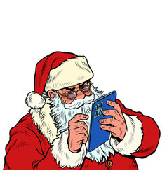 santa claus works on a mobile tablet christmas vector image