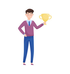 Young man holding golden cup as victory award vector
