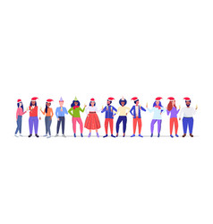 mix race people in santa claus hats holding vector image