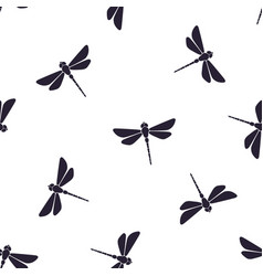 Pattern with silhouettes flying dragonfly vector