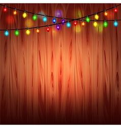 Christmas lights on wood background vector image