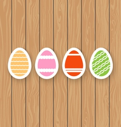 Easter eggs on a wooden background vector image