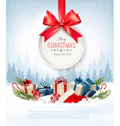 Christmas presents with a gift card and Santa hat vector