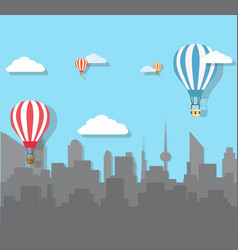 Hot air balloons over the city vector
