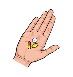 hand holding three colorful pills tablets in open vector image vector image