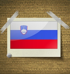 Flags Sloveniaat frame on a brick background vector image vector image