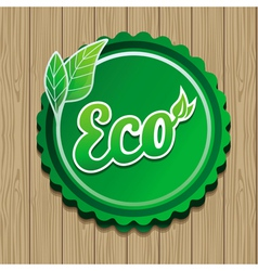 eco label - green sticker on wooden backgro vector image