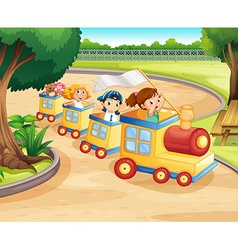 Children riding on the train in the park vector image