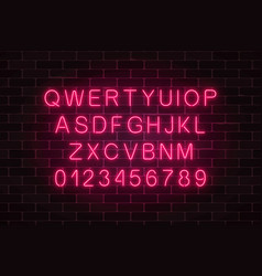 glowing neon alphabet font on dark brick wall vector image