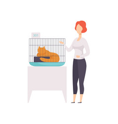 Female owner presenting her red cat in a cage at vector