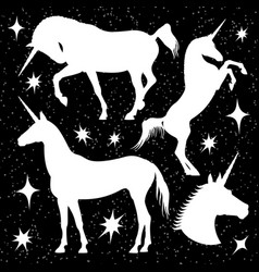 White unicorn silhouettes set with stars on black vector