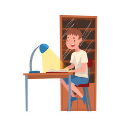cute schoolboy sitting at desk and reading book vector image