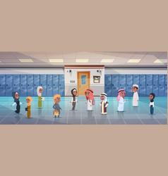 Group of arab pupils walking in school corridor vector