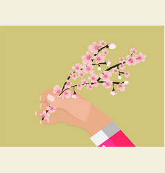 hand holding colorful branch of cherry blossoms vector image