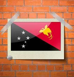 Flags Papua New Guinea scotch taped to a red brick vector image