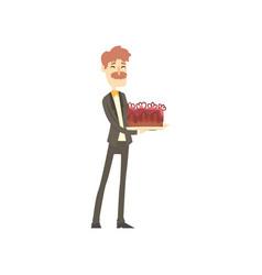 smiling businessman holding a cake cartoon vector image