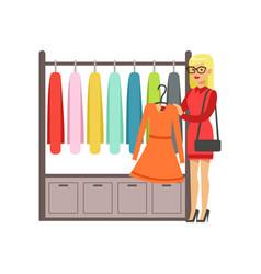 Woman choosing dress during shopping beautiful vector