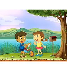 A young boy holding a bike and a girl near a vector