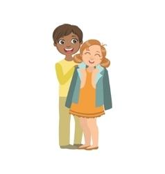 Boy putting his coat around girl s shoulders vector