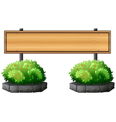 An empty signboard above the plants vector