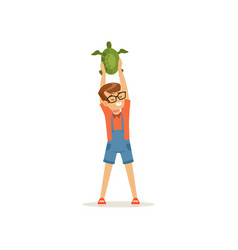 smiling boy holding green turtle over his head vector image