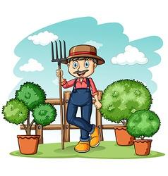 Happy gardener with a rake vector image