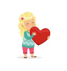 Lovely blonde little girl holding red heart happy vector