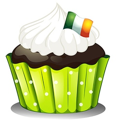 A big chocolate cupcake with the ireland flag vector
