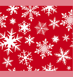 seamless snowflake pattern on red background vector image