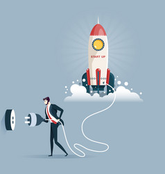 businessman plugging in a start up rocket vector image
