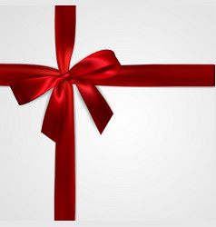 realistic red bow with crosswise red ribbons vector image