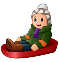 cartoon boy in green winter clothes playing a sled vector image