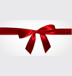 realistic red bow with red ribbons isolated on vector image