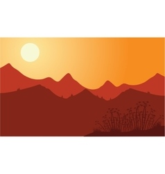 Silhouette of mountain with red background vector