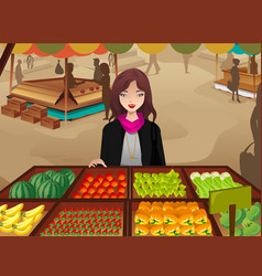 Woman shopping at a farmers market vector